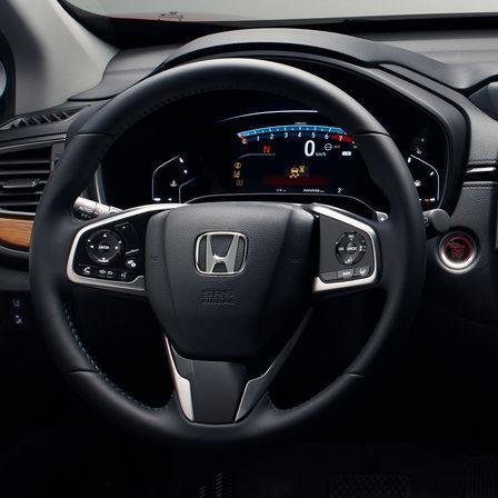 Close-up van het stuurwiel en de meters van de Honda CR-V.
