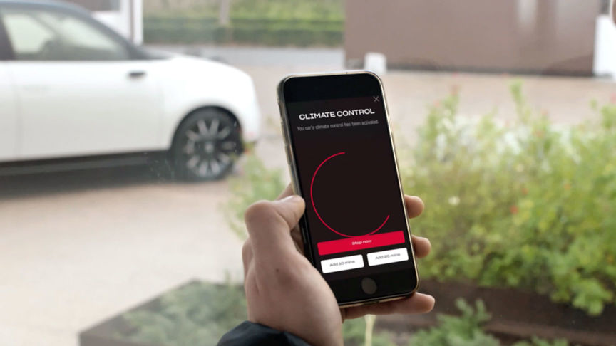 Close up of mobile phone with the My Honda Plus app Remote Battery Charge Control displayed.