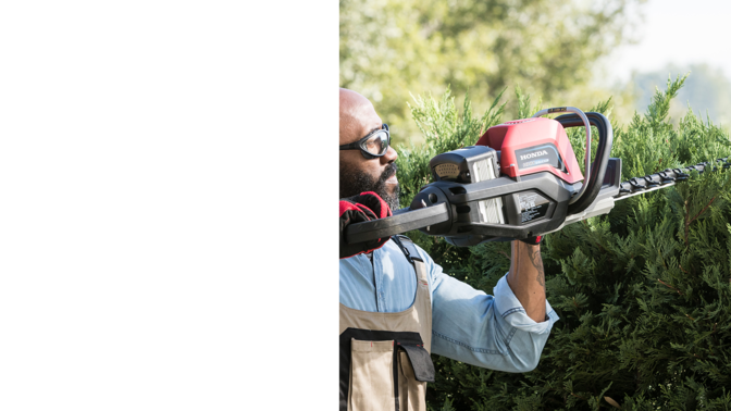 Rear-three quarter view of Honda cordless hedge trimmer with model.